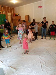 Kids dancing at a bubble themed birthday party in a garage
