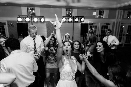 Excited bride dancing at her wedding reception at The Woodlands Club in Falmouth ME
