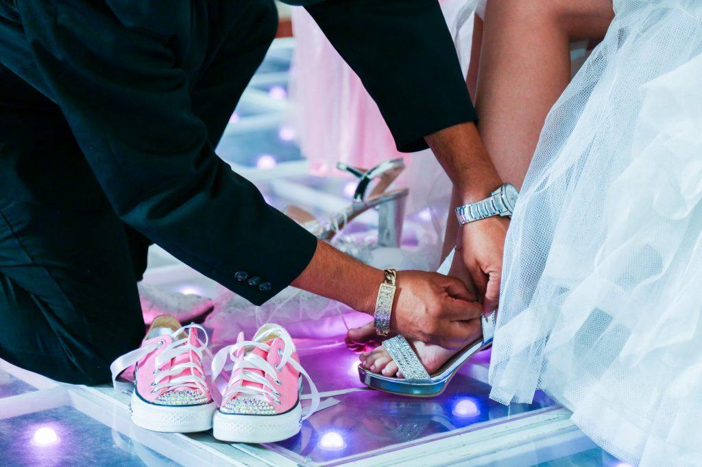 Image: https://www.pexels.com/photo/close-up-photo-of-groom-fixing-brides-shoe-strap-1758220/